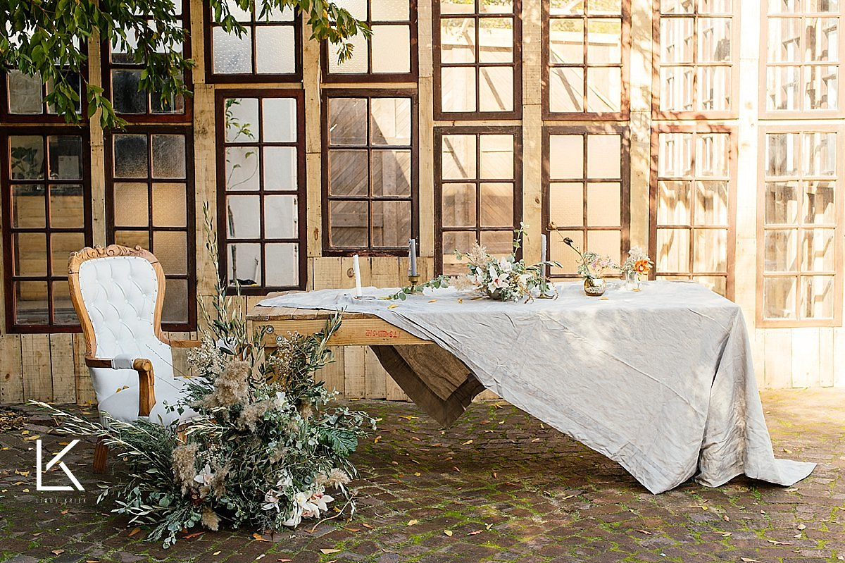 Al fresco dining with soft textures and beautiful flowers