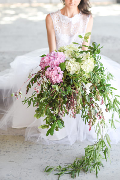 Loose arrangements, hydrangeas and gold accents makes for boho magic.