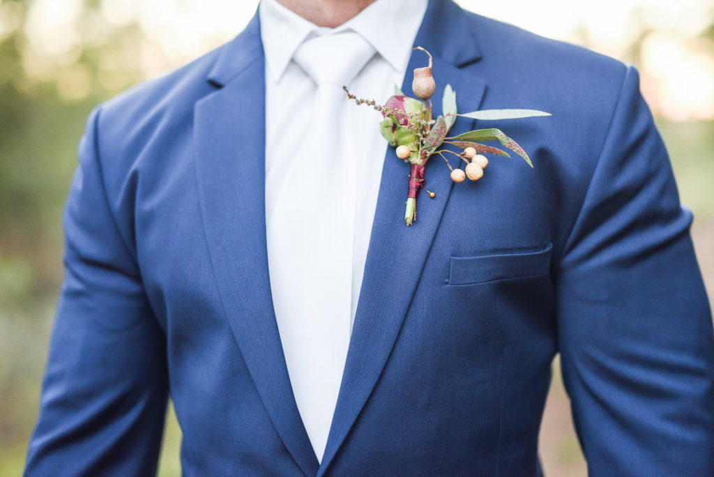 Burgundy winter wedding at Die Woud, South Africa boutonnière.