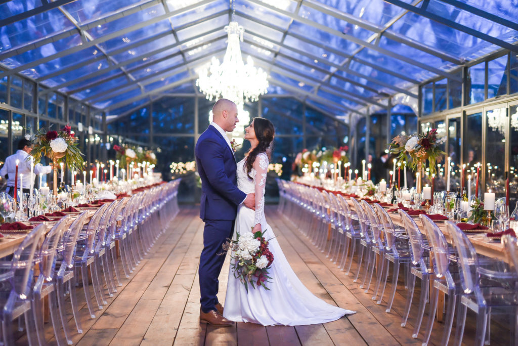 Burgundy winter wedding at Die Woud, South Africa with peonies, gold accents and high floral arrangements.